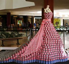 """In 2010, Fashion Institute of Design & Merchandising created an evening gown structure for Orange County's Canstruction, titled """"AdDRESSing Hunger,"""" designed by Graphic Design Student Breanne Cadabona.  It was created using nearly 8,000 canned goods including corn, peas, beans, carrots, and of course pink-labeled tuna cans. It won the People's Choice and Honorable Mention Awards."""