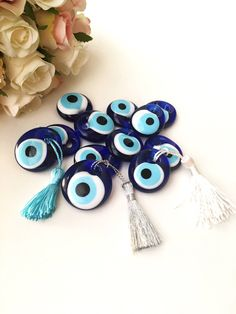 A personal favourite from my Etsy shop https://www.etsy.com/listing/524700716/wedding-favors-for-guest-100-pcs-blue 100 pcs blue evil eye beads | wedding favors for guests | evil eye beads with tassel | unique wedding favors | nazar boncuk | glass blue evil eye #bulkgift #evileyegift #tinyevileye #evileyebeads #tasselgift #weddingfavor #weddinggift