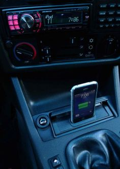 If your car doesn't have an auxillory port, you can make a DIY iPhone dock out of your ashtray using this how to guide.