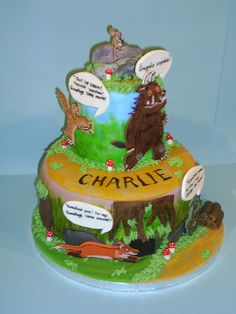My Gruffalo Cake, depicting key stages of the story going from the bottom all the way up to the triumphant mouse eating his little nut at the top. All hand modelled and painted.