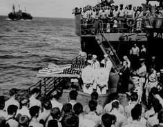 Two enlisted men of the ill-fated U.S. Navy aircraft carrier LISCOME BAY, torpedoed by a Japanese are buried at sea