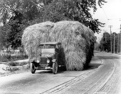 A Ford Model T truck pulling 8,000 pounds of hay, photographed by Henry Ford