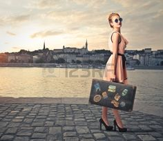 fashion woman with her suitcase on holiday Stock Photo