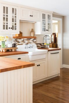 Farmhouse sink in a farmhouse kitchen with butcher block counter tops