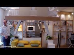 Adaptive space-saving bed snaps into ceiling when not needed - YouTube