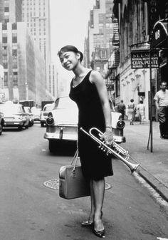 """The Jazz Scene 1960. William Claxton photographed jazz musicians for record labels. Credited as the wife of be-bop trumpeter Donald Byrd. Her name is Lorraine Glover and Byrd's song """"Elgy"""" stands for her initials."""