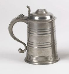 "Pook & Pook.  April 20th & 21st 2007. Lot 778.  Estimated: $2K - $3K. Realized Price: $9945.  Philadelphia pewter tankard (1795-1819), attributed to Parks Boyd, 7 1/2"" h. For an identical example, see Montgomery, A History of American Pewter, fig. 6-28."