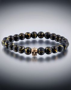 DyOh Jewelry - Desert Sun Gold Plated Black 8mm Round Bracelet with Gold Skull Inset H20-9401GB-GSKULL