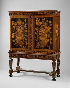 Attributed to Jan van Mekeren (Dutch, ca. 1658–1733). Cabinet on stand, ca. 1700-1710. The Metropolitan Museum of Art, New York. Ruth and Victoria Blumka Fund, 1995 (1995.371a, b) | By choosing bright yellow woods like barberry for daffodils, for instance, and by enhancing lighter woods with natural dyes, Van Mekeren achieved a rich and naturalistic palette not unlike those of contemporary flower painters. #spring