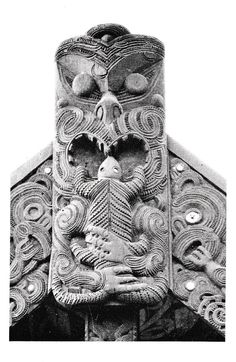The ancestor Ngarara Nui, as depicted at the apex of the barge-boards of a meeting-house at Whakarewarewa. He is eating his lizard, thereby overcoming the forces of evil