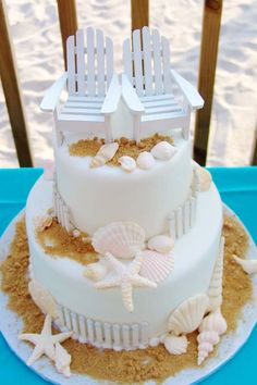 cutest beach wedding cake, sugared shells, wooden fence & mini Adirondack chairs