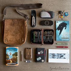 """""""Our Customer Care Manager, Drew, unpacks his satchel for this week's installment of #WhatsInMyBag . A man of varied taste, he carries a #graphicnovel or…"""""""