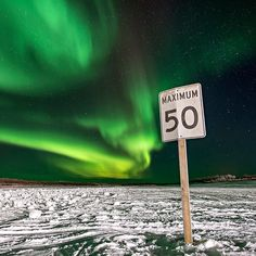 If you whistle at them theyll come down and cut off your head. When the writer @peterkujawinski visited the #NorthwestTerritories a number of people recounted their parents warnings about the #auroraborealis. In this photo by @csmphotos the aurora or #NorthernLights illuminates the sky above the ice road to Tuktoyaktuk a remote town in Canadas Northwest Territories. The ice road which is only open for a third of the year will soon be replaced by a more permanent road. This far north…