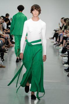 Sheets of fabric draped over rectangular wooden frames shrouded models during London designer Craig Green's Spring Summer 2016 menswear show.