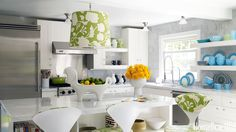"Jonathan Adler covered this Westchester kitchen's pendant light in Alan Campbell's Potalla fabric. He says that it's ""sort of crisply modern and floral-viney at the same time — perfect for the country."""