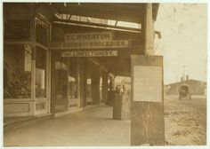 Sign on Company store, Wheaton Glass Works, Millville, N.J. Location: Millville, New Jersey.