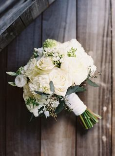 Elegant white rose wedding bouquet: http://www.stylemepretty.com/2015/11/06/rustic-elegance-at-camp-yonahnoka/ | Photography: Clark Brewer - http://www.clarkbrewerphotography.com/
