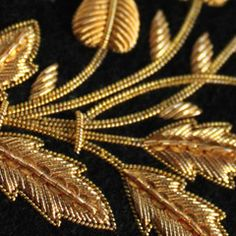 Goldwork fragment.