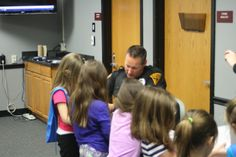 Ofc. Trampe going over the child safety kit.