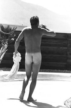 Steve McQueen in his Hollywood backyard, 1963.