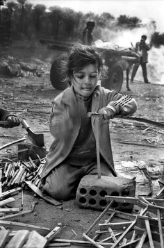Girl is working for appointment her mother,, did not go to school ,Iraq 1994 #Photography #Iraq #Baghdad #black and white #Documentary #People#world