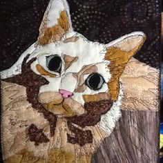 Raz also recreated in cotton fabric, thread painting & quilted