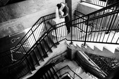 black and white | wedding | wedding photos | wedding photography | images by feliciathephotographer.com | Country Club Plaza | Kansas City | Unity Temple | first look | bride and groom | staircase meeting | groom reaction | embrace | kisses