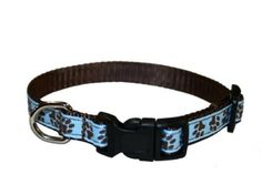 """Puppy collar - blue/brown paw prints. $9.99.   Amazon.com: Xsmall Blue/Brown Puppy Paws Dog Collar: 1/2"""" wide, Adjusts 6-12"""" - Made in USA.: Pet Supplies"""