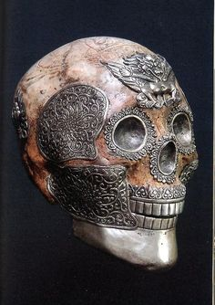 Tibetan ritual skull with elaborate silver work and garuda on the forehead
