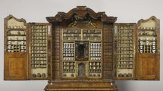 Cabinet of Curiosity comes from the Rijksmuseum; Apothecary Cabinet from Delft, 1730. The contents complete with a myriad of glass containers and pottery.