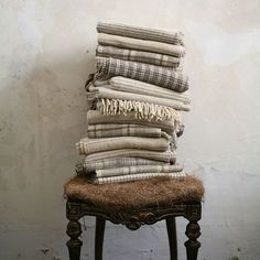When you find a trove of gorgeous throws you spend three hours artfully arranging them on top of a straw-covered chair. At least I do.