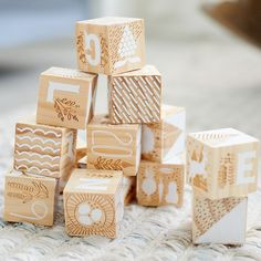 Shop Etched Wooden Blocks. This Etched Wooden Blocks set includes all the letters of the alphabet and features etching and white painted images. They were designed by artist Elizabeth Olwen and make the perfect gift or keepsake.