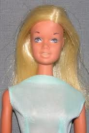 Malibu Barbie - this was my first Barbie - she had yellow lipstick and I cut her hair in a short bob - I still have her surf board too!