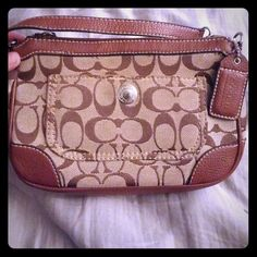 Super cute coach purse This purse is tan with dark brown c's, outlined in a lighter brown with a matching lighter brown strap. The purse is a little on the smaller side but will easily fit a full size wallet, phone, iPod even an iPad mini! The purse had a front snap pocket and a back zipper pocket. The inside in all tan and has 2 phone pockets and another zipper pocket. There are a few very small pen marks on the inside and small black spot on the front leather part. I don't believe this is…