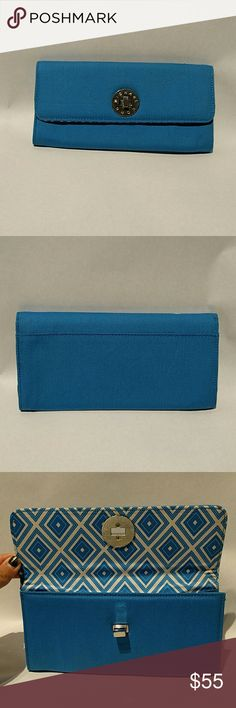 Michael Kors cotton wallet clutch in aqua blue Michael Kors brand clutch or wallet in blue cotton with silver hardware and geometric patterned interior. Single pocket 8.75x4.25. New without tags Michael Kors Bags Wallets