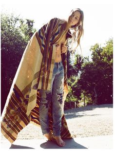 boyfriend jeans // navajo blanket // long hair don't care // modern bohemian // southwest muse // carefree // young and free // portrait of a pretty girl
