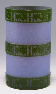 Josef Hoffmann. Very rare vase, 1911. Made by Joh. Loetz Wd., Klostermühle. Cased glass, milk white, purple and green. Etched flower bands in the Wiener Werkstätte style. H. 16.8 cm.  |  SOLD 19,000 EUR, 2015