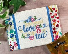 Enjoy your cup of tea with this pretty garden theme mug rug! It would also be a perfect gift for your tea loving friend! She'll love you for thinking of her with this thoughtful gift. #teagifts #teamugrug #teacoaster #tealovergift Bridal Shower Flowers, Bridal Shower Gifts, Tea Gifts, Coffee Lover Gifts, Housewarming Gift Baskets, Gift Of Faith, Tea Coaster, Christian Gifts For Women, Embroidered Gifts