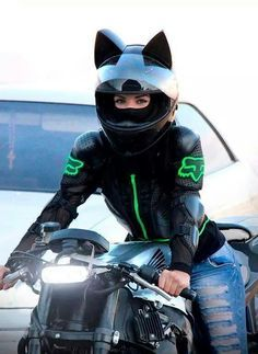 Female biker with cat ear helmet