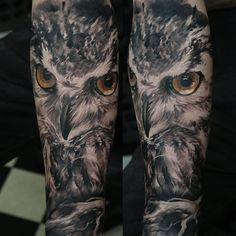 A black and grey tattoo piece of a golden-eyed owl by artist Domantas Parvainis. | Intenze ink