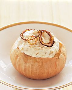 Caramelized Onion Dip - Cream cheese, sour cream, and lots of caramelized onions make this dip deliciously addictive. Roast and hollow out large Spanish onions to make the decorative serving bowls