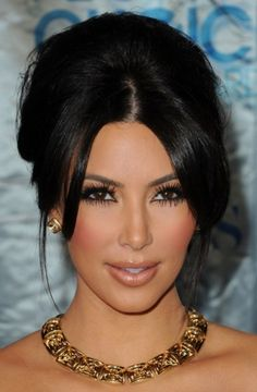 Honestly, I think Kim Kardashian is perfection!  I love her hair, face shape, make up!!  I think she is beyond gorgeous!!