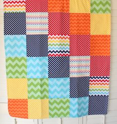 Large square patchwork, plain fleece/flannelette backing, no batting, sewn right sides facing, turn inside out, stitch down double row around edges, maybe quilt along edges of each row.