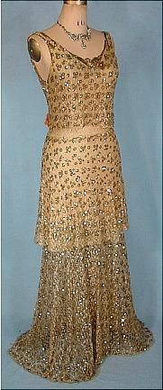 1930s gold sequined and and metallic net gown.  Bias cut, scoop neck, sleeveless.  The gown falls in 3 distinct layers, creating a 'waterfall' effect - a the waist, at the knees and along a slightly sweeped hemline.