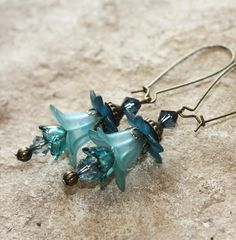 Jaimee Blue Lucite Flower earrings with antique brass findings Vintage Chic. $9.99, via Etsy.
