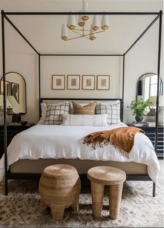 "I used a four-poster and dropped the ceiling light to help create a sense of intimacy for guests,"" Parkinson says of her design for this bedroom. Because the room is located in the basement, she paid close attention to the symmetry in this layout and used mirrors to maximize natural light. Use of several different textures and antique-inspired decor makes the room a timeless oasis for guests."