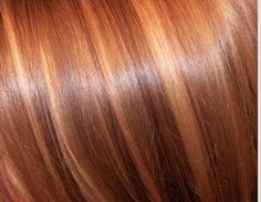 Red / light brown hair with golden highlights.