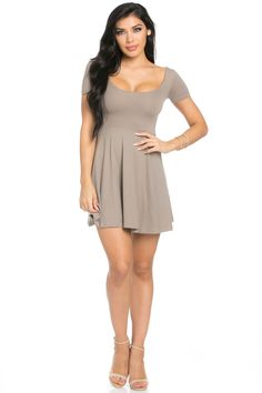 Every girl needs a simple mini dress that she can pull on for dinner, the movies, and everywhere in between. This taupe short-sleeved dress is the perfect addition to your collection. It's crafted fro
