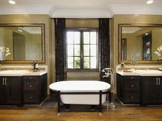 Golden Bathroom: This master bath is enhanced by an optional freestanding tub, which finds a home between two split vanities. His-and-hers vanities and thick crown molding provide an opulent ambiance. From HGTVRemodels.com