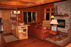 Lake Wisconsin Cabin has Rustic cherry flooring and hickory cabinetry throughout. 3 floors of great vacation spaces and a full bar. Sleeps up to 12.
